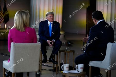 President Donald Trump speaks during a Fox News virtual town hall from the Lincoln Memorial, in Washington, co-moderated by FOX News anchors Bret Baier and Martha MacCallum