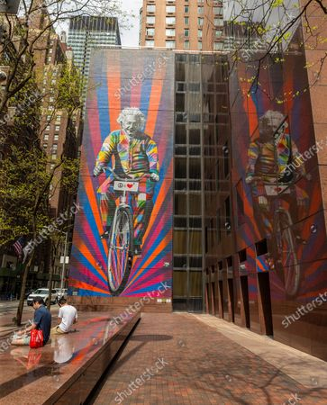People enjoy warm spring day on Third Avenue with mural of Albert Einstein by artist Eduardo Kobra amid COVID-19 pandemic