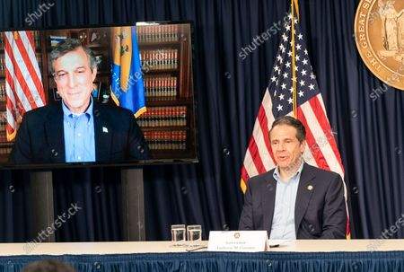 Stock Picture of Delaware Governor John Carney dial in and seen on screen at Governor Andrew Cuomo daily media briefing on COVID-19 pandemic at Manhattan office