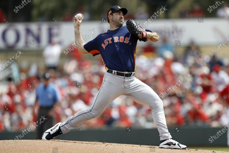 Houston Astros pitcher Justin Verlander throws during the first inning of the team's spring training baseball game against the St. Louis Cardinals in Jupiter, Fla. Sixty-five players would earn at least $100,000 each time their team wins or loses if the pandemic-delayed major league season get under way, according to an analysis of their contracts by The Associated Press. Verlander would earn $203,704