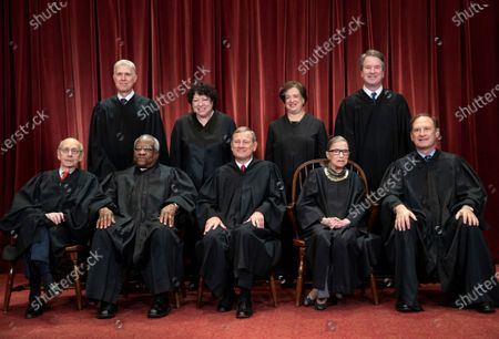 The justices of the U.S. Supreme Court gather for a formal group portrait to include the new Associate Justice, top row, far right, at the Supreme Court building in Washington. Seated from left: Associate Justice Stephen Breyer, Associate Justice Clarence Thomas, Chief Justice of the United States John G. Roberts, Associate Justice Ruth Bader Ginsburg and Associate Justice Samuel Alito Jr. Standing behind from left: Associate Justice Neil Gorsuch, Associate Justice Sonia Sotomayor, Associate Justice Elena Kagan and Associate Justice Brett M. Kavanaugh. On, the Supreme Court for the first time audio of court's arguments will be heard live by the world and the first arguments by telephone