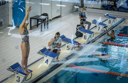 A picture taken through a window of Italian Olympic swimmer Federica Pellegrini (L) during a training session in Verona, Italy, 04 May 2020. The Tokyo 2020 Olympic Games will start on 23 July 2021 after the games were postponed due to the coronavirus pandemic.
