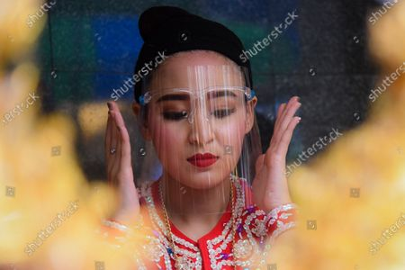 Dancers perform wearing  face shield during the dance  of Erawan Shrine to prevent  new strains of the corona virus 2019 or the COVID-19.
