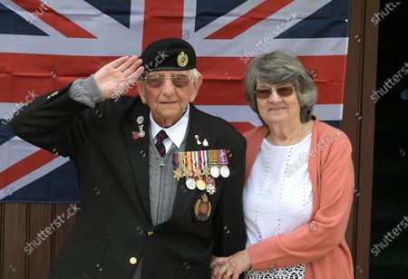 Don and wife Sandra. D-Day veteran Don Sheppard celebrates his 100th Birthday at his home in Basildon Essex. The former Royal Engineers Sapper arrived on Juno beach on 6th June 1944 with the 155 Brigade Highland Division on a landing craft with his Bren gun equipped scout car. D-Day was not the first time Don had seen action as he had previously served in North Africa and Sicily. After breaking through enemy lines in August 1944 he continued through Belgium, Holland and eventually Germany where he was involved in the liberation of prisoners in the Bergen-Belsen concentration camp. Mr Sheppard confesses he was extremely fortunate to be only wounded once when taking cover from enemy bombing, in 2008 during a scan at Basildon Hospital it was found that a piece of shrapnel had sat in his lung undetected for 64 years from this incident.