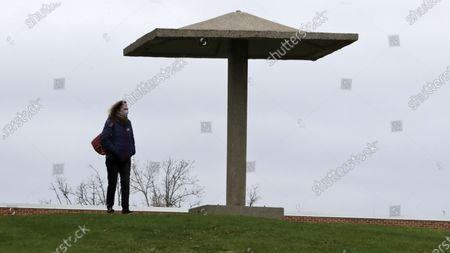 Maureen Schubert, who was at the protest in 1970, looks toward the memorials from the pagoda on Blanket Hill, in Kent, Ohio. The Ohio National Guard opened fire on unarmed college students during a war protest at Kent State University on May 4, 1970. Four students were killed, and nine others were injured. Not all of those hurt or killed were involved in the demonstration, which opposed the U.S. bombing of neutral Cambodia during the Vietnam War