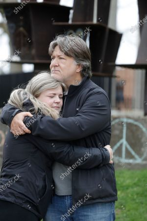 Hannah Hooper and her dad, Michael, hug at a memorial for the students injured and killed in 1970, in Kent, Ohio. The Ohio National Guard opened fire on unarmed college students during a war protest at Kent State University on May 4, 1970. Four students were killed, and nine others were injured. Not all of those hurt or killed were involved in the demonstration, which opposed the U.S. bombing of neutral Cambodia during the Vietnam War. Hannah will graduate from Kent State in 2020 and Michael graduated in 1971