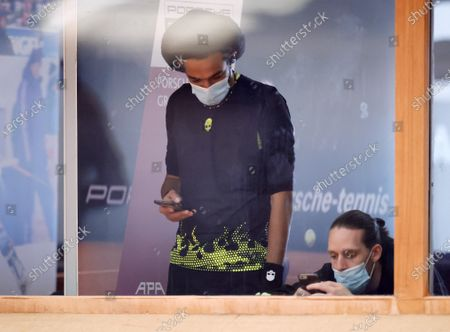 Player Dustin Brown (L) watches during a live stream of an tennis exhibition series match in Hoehr-Grenzhausen, Germany, 04 May 2020. Countries and Sports organizers around the world are taking increased measures to stem the widespread of the SARS-CoV-2 coronavirus which causes the Covid-19 disease.