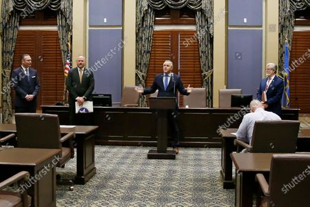 Stock Image of Senate President Pro Tempore Greg Treat, center, R-Oklahoma City, speaks at a news conference as at left, Oklahoma House Speaker Charles McCall, R-Atoka, and House Appropriations and Budget Chairman Kevin Wallace, R-Wellston, and at right, Senate Appropriations Chairman Roger Thompson, R-Okemah, look on. House and Senate leaders announced a $7.7 billion spending plan for the upcoming fiscal year that taps state savings and temporarily diverts funding from pension plans and transportation projects, in Oklahoma City