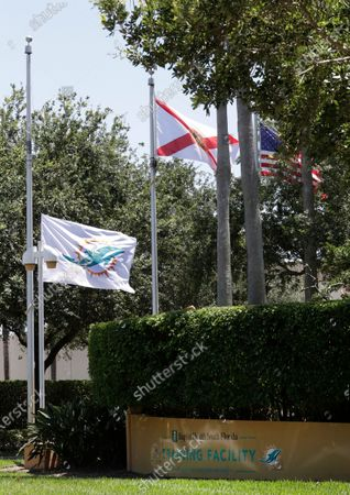 The Miami Dolphins team flag flies at half mast outside the NFL football team's training camp facility, in Davie, Fla. Former Dolphins coach and Hall of Famer Don Shula died Monday at his home in Indian Creek, Fla. He was 90