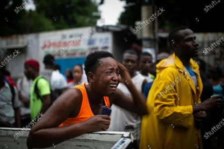Relative of Rigueur Pierre Richard, who was killed in a drive-by shooting two blocks from the national palace, is overcome with grief during a protest against fuel shortages and demanding the resignation of President Jovenel Moise in Port-au-Prince, Haiti, . The image was part of a series of photographs by Associated Press photographers which was named a finalist for the 2020 Pulitzer Prize for Breaking News Photography