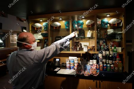 Tom Valentin, Director Of Food And Beverage for Shula's Hotel & Golf Club, shows off some memorabilia associated with former Miami Dolphins head coach Don Shula, at the hotel and golf club in Miami Lakes, Fla. Shula died Monday at his home in Indian Creek, Fla. He was 90