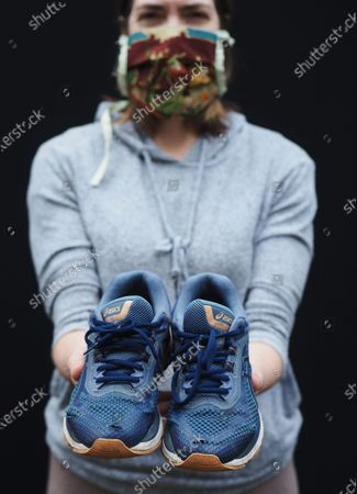 """Stock Picture of Exclusive - Lisa Draho with a pair of running shoes. She says that she """"...avoids the park and walks for about two hours. I aim for 10,000 steps a day."""""""