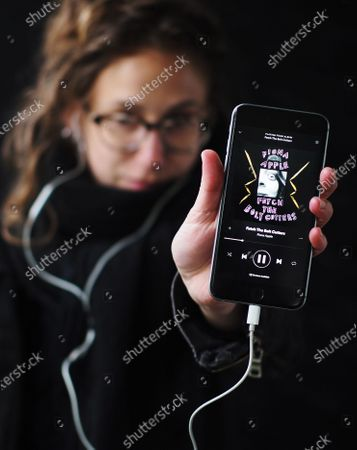 """Exclusive - Alex LSrm with the new Fiona Apple album, 'Fetch The Bolt Cutters' on her smartphone. She says, """"This album has been my go-to when I go on my daily walks."""""""