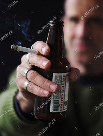 """Exclusive - Master Carpenter and musician Jonas Read with a beer and a cigarette. Always one for humor, he says, """"I always wait until at least 11:30am."""""""