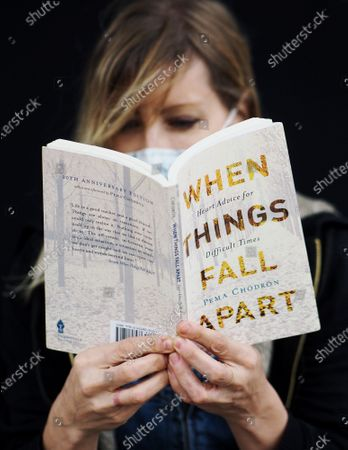 Exclusive - Massage therapist Kym O'Neill with her favorite book, 'When Things Fall Apart' by Pema Chodron, during this period of self isolation.