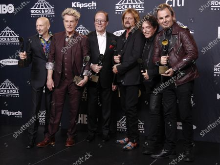 Members of Journey, Steve Smith, from left, Ross Valory, Aynsley Dunbar, Gregg Rolie, Neal Schon and Jonathan Cain at the 2017 Rock and Roll Hall of Fame induction ceremony in New York. Journey is the latest act to cancel their 2020 tour because of the coronavirus pandemic. The rock band was supposed to kick off their new tour on May 15 but announced Monday that they would no longer hit the road. Band members said they decided to cancel the tour, instead of postponing it, so that concertgoers would qualify for immediate refunds