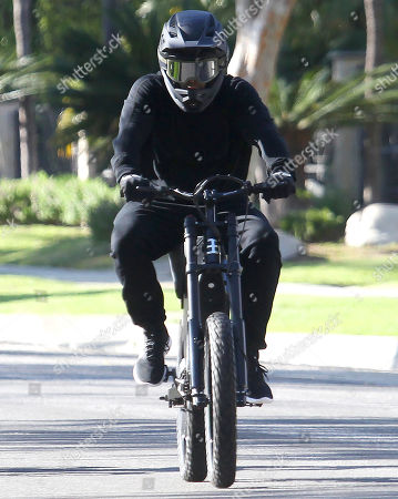 Jason Statham rides his bike