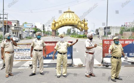 Punjab police personnel manning barricades during lockdown at Golden Gate on May 4, 2020 in Amritsar, India. The second extension of coronavirus-induced lockdown began across the country from Monday. The two-week extension was announced by the government on Friday. Lockdown 3. 0 began as the number of Covid-19 cases in the country breached the 40,000-mark.