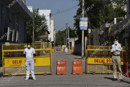 Security personnel manning barricades at the entrance of a lane where 41 covid-19 positive cases were found on May 4, 2020 in New Delhi, India. The second extension of coronavirus-induced lockdown began across the country from Monday. The two-week extension was announced by the government on Friday. Lockdown 3. 0 began as the number of Covid-19 cases in the country breached the 40,000-mark.