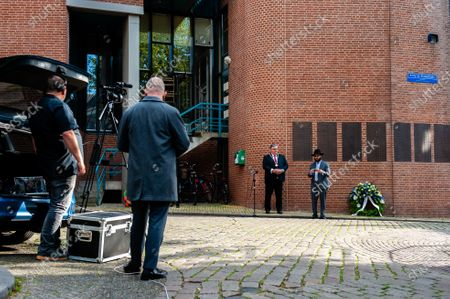 """A camera man is seen recording during the ceremony. The commemorations took place at the """"Kitty de Wijze"""", a monument that  has become the symbol of the Jewish in Nijmegen who were deported and never come back. This year because of the current situation, the ceremony was held without an audience, just with the presence of Rabbi M. Levin and Mayor of Nijmegen Hubert Brushwood is also the chairman of the Security Council in the country. The memorial service in the Sint Stevens church was canceled this year."""