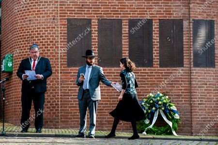 """A Jews girl is seen giving a book to Rabbi M. Levin during the ceremony. The commemorations took place at the """"Kitty de Wijze"""", a monument that  has become the symbol of the Jewish in Nijmegen who were deported and never come back. This year because of the current situation, the ceremony was held without an audience, just with the presence of Rabbi M. Levin and Mayor of Nijmegen Hubert Brushwood is also the chairman of the Security Council in the country. The memorial service in the Sint Stevens church was canceled this year."""