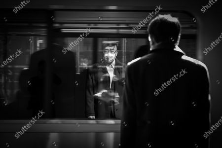 (01/27) A commuter wearing a face mask is reflected in a train window as it arrives at the platform of Shibuya train station in Tokyo, Japan, 14 April 2020, a week after the Japanese government declared a state of emergency on parts of Japan including Tokyo and Osaka, in a bid to slow the spread of the coronavirus SARS-CoV-2 which causes the Covid-19 disease.  EPA-EFE/DAI KUROKAWA  ATTENTION: For the full PHOTO ESSAY text please see Advisory Notice epa08401867 Image converted to black and white.