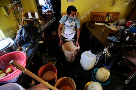 "Carlos Beltran  worker of ""La Paloma Azul""  who has closed  due to the lockdown has been forced to make Pulque at home during the Coronavirus outbreak. Carlos Beltran, who has been making this pre-Hispanic drink  for more than 12 years, offers home delivery to survive the crisis."