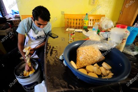"Stock Photo of Carlos Beltran  worker of ""La Paloma Azul""  who has closed  due to the lockdown has been forced to make Pulque at home during the Coronavirus outbreak. Carlos Beltran, who has been making this pre-Hispanic drink  for more than 12 years, offers home delivery to survive the crisis."