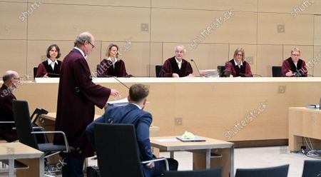 The 6th Civil Senate at the Federal Court of Justice (BGH), (L-R) Stefanie Roloff, Vera von Pentz, Stephan Seiters (Chairman), Christiane Oehler and Oliver Klein, opens the hearing on a lawsuit against the car manufacturer Volkswagen in the diesel scandal at the Federal Supreme Court (BGH) in Karlsruhe, Germany, 05 May 2020. The plaintiff, Herbert Gilbert, sits on the far left, his lawyer Matthias Siegmann stands. The 6th Civil Senate is hearing a lawsuit against the car manufacturer VW in the diesel scandal about compensation for damages for manipulated diesel vehicles. Gilbert wants to return the used car he bought in 2014 to Volkswagen and be reimbursed the full price of around 31,500 euros.