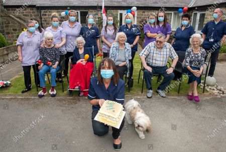 They had no one left to turn to for help. Running dangerously low on protective kit, the staff at Croft House care home could not afford to pay the exorbitant prices demanded by ruthless profiteers. Exhausted carers were asked to work through their tea breaks so that their masks would not have to be discarded. But that all changed when Mail Force delivered a vital consignment of personal protection equipment yesterday. Carers and managers danced, cheered and shed 'tears of joy' as the precious cargo arrived at the home in the village of Eastburn, near Keighley, West Yorkshire. 'I can't begin to explain the difference this will make to the staff,' co-owner Vicky Bateman said. 'That's amazing, amazing amazing. I feel so tearful with joy. Honestly, we can't thank Mail Force enough. It's the best campaign ever.' Many of the staff on duty waved flags as They crowded into the garden to watch the consignment arrive. They even baked a cake with the words 'Thank you Mail Force' in blue icing on it.