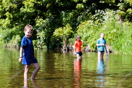 Stock Picture of Cillian, Aoibhe and Anna Murray enjoying the Dodder river in Rathfarnham