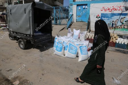 """This picture taken on March 23, 2020 shows a view close the food distribution centers in Khan Younis in the southern of Gaza strip, on March 23, 2020. The UN agency for Palestinian refugees, UNRWA, has temporarily suspended aid to the Gaza Strip after the detection of two coronavirus cases in the territory, """"UNRWA food aid will be temporarily suspended until finding a safer way to deliver aid,"""" UNRWA spokesperson Adnan abu Hasna said in a statement."""