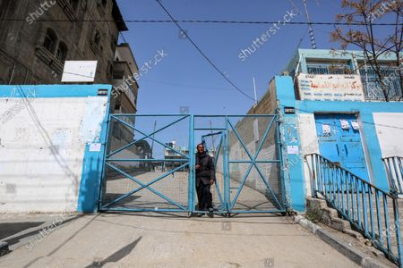 """Stock Picture of This picture taken on March 23, 2020 shows a view close the food distribution centers in Khan Younis in the southern of Gaza strip, on March 23, 2020. The UN agency for Palestinian refugees, UNRWA, has temporarily suspended aid to the Gaza Strip after the detection of two coronavirus cases in the territory, """"UNRWA food aid will be temporarily suspended until finding a safer way to deliver aid,"""" UNRWA spokesperson Adnan abu Hasna said in a statement."""