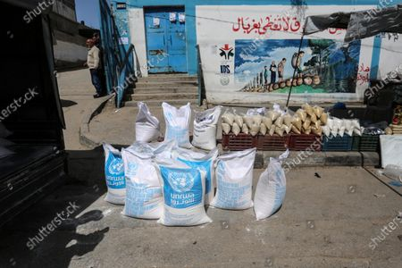"""Stock Photo of This picture taken on March 23, 2020 shows a view close the food distribution centers in Khan Younis in the southern of Gaza strip, on March 23, 2020. The UN agency for Palestinian refugees, UNRWA, has temporarily suspended aid to the Gaza Strip after the detection of two coronavirus cases in the territory, """"UNRWA food aid will be temporarily suspended until finding a safer way to deliver aid,"""" UNRWA spokesperson Adnan abu Hasna said in a statement."""