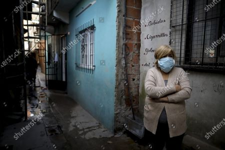 """Stock Image of Cristina Rodriguez stands outside her home during a government-ordered lockdown to curb the spread of the new coronavirus in the """"Villa 31"""" neighborhood of Buenos Aires, Argentina, . According to official data, the number of confirmed cases of COVID-19 disease in this slum have increased in the past week, putting authorities on high alert"""