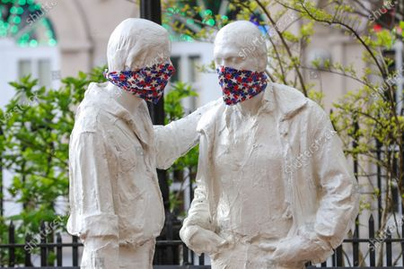 Protective masks placed on a sculpture by George Segal (1924-2000), created in remembrance of events at the Stonewall Inn and the fight for LGBT rights.