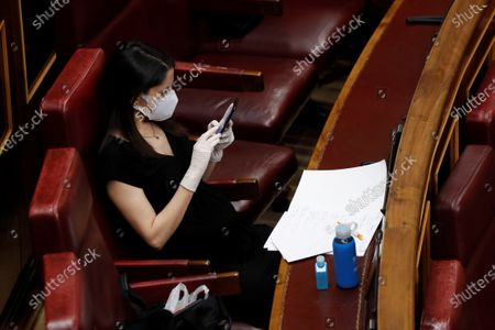 Ciudadanos (Citizens) party's leader Ines Arrimadas looks at her mobile phone as she attends a plenary session at Lower Chamber of Spanish Parliament, in Madrid, Spain, 06 May 2020. Spanish PM Pedro Sanchez comes back to Congress of Deputies to achieve the fourth extension of the emergency state to carry out the de-escalation plan amid COVID-19 pandemic.