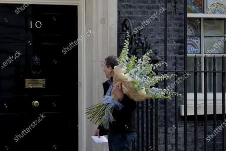 Stock Photo of Flowers are delivered to 10 Downing Street in London, after British Prime Minister Boris Johnson's partner Carrie Symonds gave birth to a baby boy a week ago today, in Downing Street, London, . The couple have named the baby Wilfred Lawrie Nicholas Johnson
