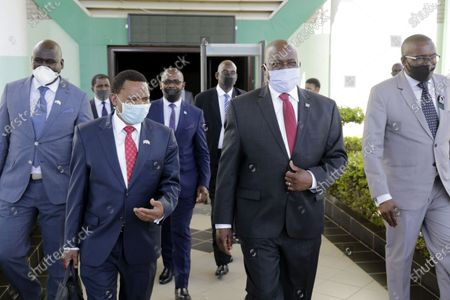 Botswanan President Mokgweetsi Masisi (2nd R) and Vice President Slumber Tsogwane (2nd L) leave the parliament in Gaborone, Botswana, May 5, 2020. Botswana has intentions to slowly open up the economy following a five weeks lockdown, ending on Thursday, to fight COVID-19 pandemic.     The country's legislators will convene an emergency parliament meeting on Wednesday to discuss new regulations expected to usher in opening of businesses and schools, under strict supervision.     According to proposed regulations, presented by President Mokgweetsi Masisi to parliament on Tuesday, the Southern Africa country wants to gradual allow businesses, traders or school to operate after satisfying Health Services Director or any authorized official that they will prevent the spread of COVID-19.