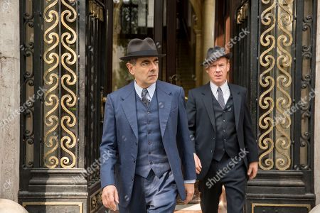 ROWAN ATKINSON as Maigret. and SHAUN DINGWALL as Janvier.