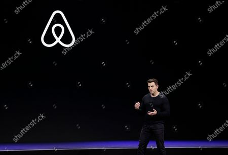 Airbnb co-founder and CEO Brian Chesky speaks during an event in San Francisco. In a world where social distancing has become a part of life and people are staying home in hopes of avoiding the coronavirus, companies that have built their business on the sharing economy are struggling. Ride-hailing companies are laying off thousands of employees as their once-loyal customers stay indoors. Those who venture out fear infection, and try to limit contact with others to minimize risk. And home-sharing apps such as Airbnb are slashing staff as the thought of opening living spaces to strangers begins to feel like an anachronism