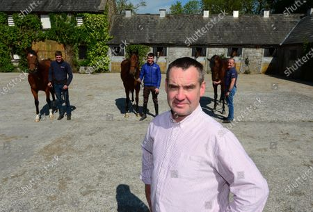 Stock Photo of Ballyhannon House Stables, Quin, Co.Clare. Trainer Johnny Hassett and staff with breeze up horses for this year's sales Patrick McLoughlin (American Pharoah), Evan McNamara (Gleneagles) and Shane O'Brien (Candy Ride).