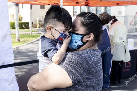Erica (R) holds her son Aidin in her arms to comfort him after he underwent a test for Covid-19 at McKinley Elementary School amid the coronavirus pandemic in Compton, South of Los Angeles, California, USA, 28 April 2020 (Reissued 07 May 2020). On the second Sunday of May every year, several countries celebrate mothers and all the hard work they endure for almost nothing in return. However this year they are especially going through demanding times. Coronavirus has forced mothers to be even more protective but this time against an invisible enemy, yet they have also put on display their fun and playful personality concurrently with their studious side. Along with their everlasting love and care they have shown inspiring bravery during these challenging times.
