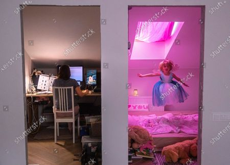Four-year-old Sofia jumps playing in her room while her mother works in home office during the lockdown to combat the spread of the SARS-CoV-2 coronavirus which causes the COVID-19 disease, in Domodedovo, outside Moscow, Russia, 27 April 2020 (Reissued 07 May). On the second Sunday of May every year, several countries celebrate mothers and all the hard work they endure for almost nothing in return. However this year they are especially going through demanding times. Coronavirus has forced mothers to be even more protective but this time against an invisible enemy, yet they have also put on display their fun and playful personality concurrently with their studious side. Along with their everlasting love and care they have shown inspiring bravery during these challenging times.