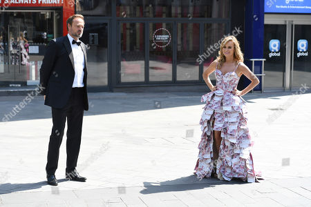 Amanda Holden and Jamie Theakston pose outside Heart studios as they celebrate Heart's Make Me a Millionaire Competition Winner