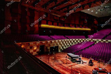 Editorial photo of Farid Sheek and Maya Fridman concert in empty hall, Rotterdam, Netherlands - 07 May 2020