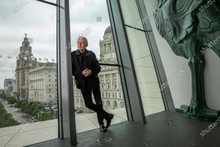 Mike McCartney, 75, brother of Sir Paul McCartney of The Beatles. Mike is a member of the Liverpudlian performance artists The Scaffold, songwriter and photographer but never left his hometown city. Mike is pictured in the Museum of Liverpool which overlooks the famous Liver Building with it's famous Liverbirds which adorn the top turrets.His 1974 album McGear, produced by brother Sir Paul McCartney has been reissued by Esotric.