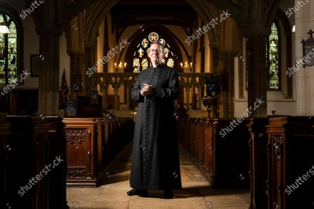 Stock Picture of the Rev. Reverend Richard Coles where he is the parish priest of St. Mary's Church in Finedon, Northamptonshire. Reverend Richard Coles was member of 80's pop band The Communards before working in the church and being ordained in 2005. His partner David Oldham recently died.