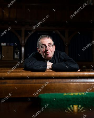 the Rev. Reverend Richard Coles where he is the parish priest of St. Mary's Church in Finedon, Northamptonshire. Reverend Richard Coles was member of 80's pop band The Communards before working in the church and being ordained in 2005. His partner David Oldham recently died.