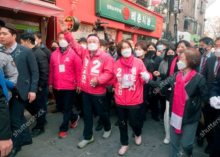 Hwang Kyo-ahn and Choi Ji-Young, Apr 11, 2020 : Wearing masks to prevent COVID-19 coronavirus infection, Hwang Kyo-ahn (C), chairman of South Korea's main opposition United Future Party (UFP) and his wife Choi Ji-Young (center R) attend his election campaign for the April 15 parliamentary elections in his electoral district of Jongno Ward in Seoul, South Korea. Hwang's headband reads,'Economic Renewal'. Hwang is running for the election in Jongno, a symbolic constituency in Korean politics where influences in politics are elected. Lee Nak-yeon, former prime minister of South Korea and a candidate of the ruling Democratic Party is also running in the constituency for the general elections. Lee and Hwang have been ranked as the first and second as the next president of South Korea in recent polls. The quadrennial elections will fill the 300-seat unicameral National Assembly of South Korea.